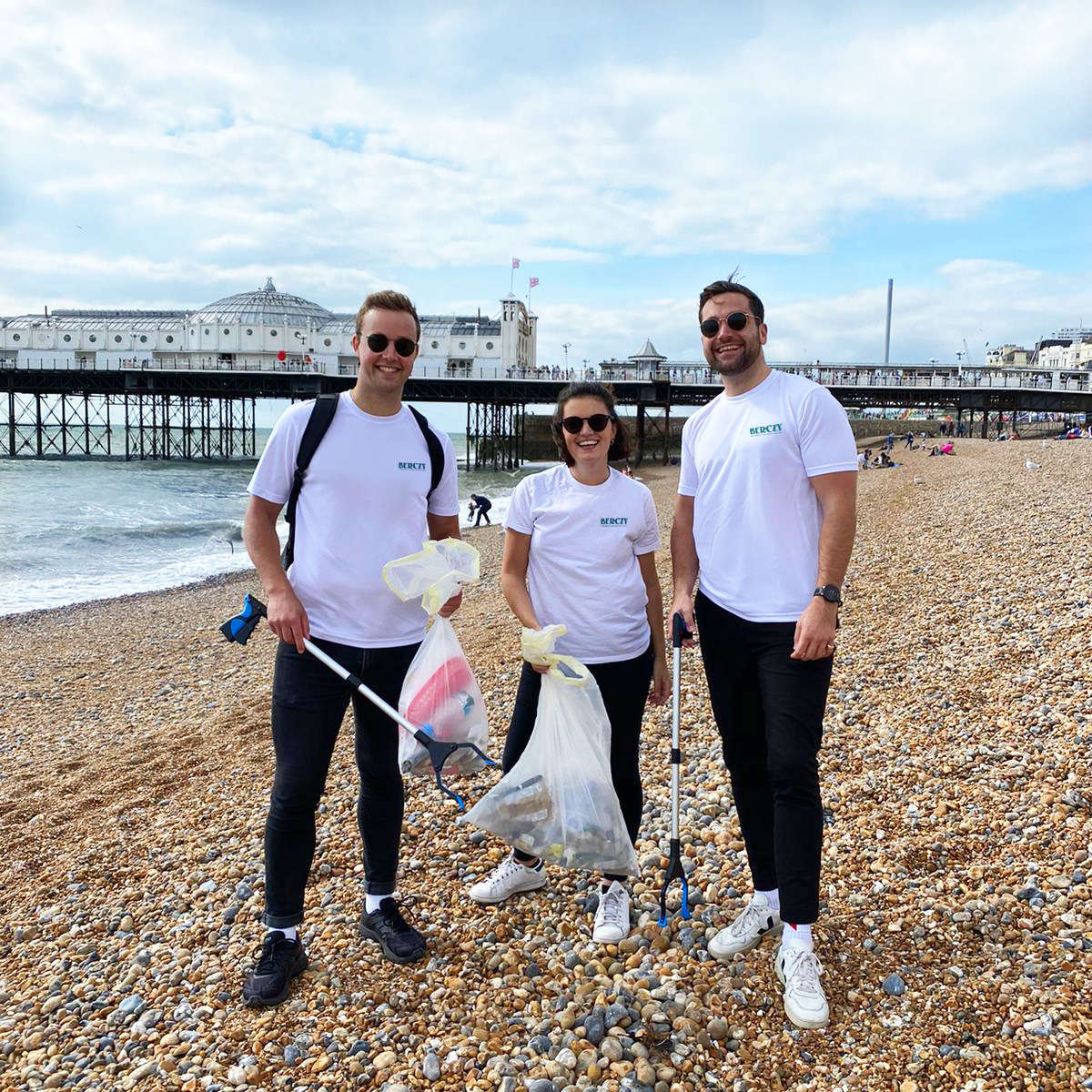 The founding team at Berczy doing a litter pick on a beach