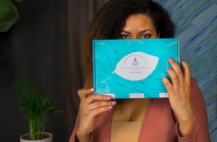 Founder of Theenk Tea holding her startup's packaging